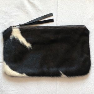 Black and white fur clutch with zip closure
